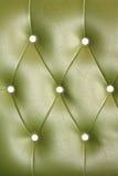 Struttura del sofà di cuoio verde d'annata per fondo Immagini Stock Libere da Diritti