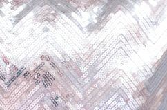 Struttura del tessuto con gli zecchini d'argento di luccichio fotografia stock