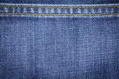 Struttura del tessuto dei jeans del denim o fondo dei jeans del denim con la cucitura per progettazione Fotografie Stock