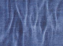 Struttura del tessuto del denim con le ondulazioni Fotografia Stock