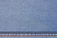Struttura del tessuto delle blue jeans immagine stock