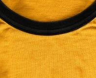 Struttura del tessuto di cotone - arancia luminosa con il collare nero Immagine Stock