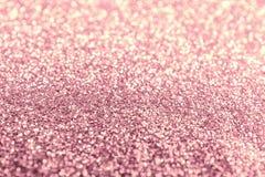 Struttura del tessuto rosa di scintillio dell'oro come fondo, primo piano immagini stock libere da diritti