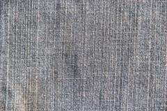 Struttura del tessuto rotta jeans del denim Immagine Stock