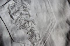 Struttura del tessuto rotta jeans del denim Fotografia Stock
