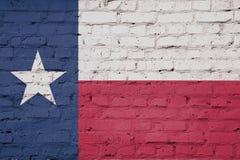Struttura della bandiera del Texas su una parete illustrazione di stock