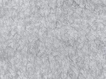 Struttura della carta da parati grigia con un modello Fotografie Stock
