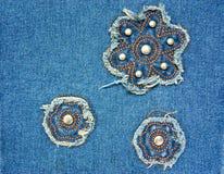 Struttura della fine del tessuto delle blue jeans su fotografia stock