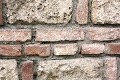 Struttura della parete dell'arenaria e del muro di mattoni Fotografie Stock