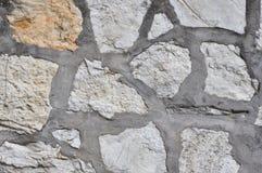 Struttura della parete di pietra con cemento grigio fotografia stock