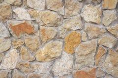 Struttura della parete di pietra Parete naturale antica del ciottolo come backgrou fotografie stock