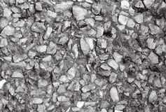 Struttura della parete di pietra, piccola pietra grigia immagine stock