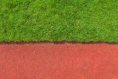 Struttura della pista e dell'erba Immagine Stock Libera da Diritti