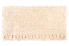 Struttura della tela da imballaggio della decorazione dell'etichetta della tela di sacco su bianco Fotografia Stock