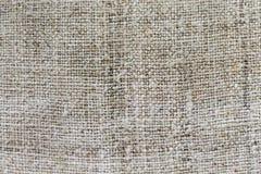 Struttura della tela di sacco della tela da imballaggio o fondo grigio e spazio vuoto fotografie stock