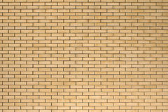 Struttura di alta risoluzione di un muro di mattoni giallo Stenditura del horizonta Immagine Stock Libera da Diritti