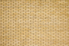Struttura di alta risoluzione di un muro di mattoni giallo Stenditura del horizonta Fotografie Stock