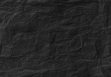 Struttura di carta sgualcita il nero Priorità bassa e carta da parati Immagine Stock