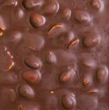 Struttura di cioccolato al latte con i dadi Fotografia Stock Libera da Diritti