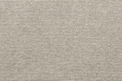 Struttura di colore beige pallido tricottato del tessuto a strisce immagine stock