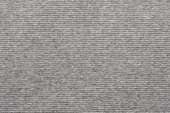 Struttura di colore grigio bianco tricottato del tessuto a strisce fotografia stock