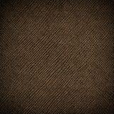 Struttura di cuoio marrone senza cuciture con il riflesso dorato Fotografia Stock