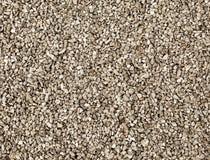 Struttura di ghiaia grigia su terra immagine stock