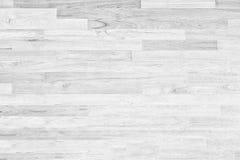 Struttura di legno bianca del fondo della parete, fine sul pavimento di legno Fotografia Stock