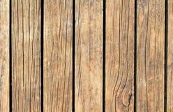 Struttura di legno d'annata con le linee verticali Fondo di legno marrone caldo per l'insegna naturale Immagine Stock