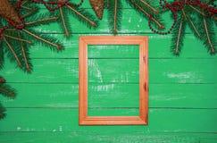 Struttura di legno della foto su un fondo verde Immagini Stock Libere da Diritti