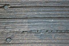 Struttura di legno esposta all'aria della plancia immagine stock