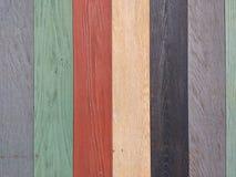 Struttura di legno, Grey, verde, rosso, giallo, fondo di legno nero, parete variopinta della tavola di legno Fotografia Stock