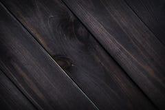Struttura di legno scura Plance di legno marroni del fondo vecchie immagine stock libera da diritti