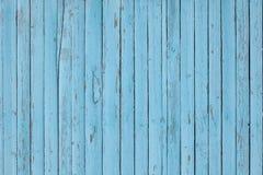 Struttura di legno verticale colorata blu-chiaro del fondo delle plance fotografia stock