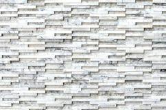 Struttura di marmo moderna del fondo della parete di pietra del mattone Fotografia Stock