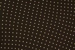 Struttura di piccolo tessuto in bianco e nero del pois fotografia stock
