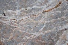 Struttura di pietra con le crepe ed i fori Fotografia Stock