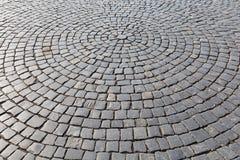 Struttura di pietra della pavimentazione di strada della via Immagine Stock