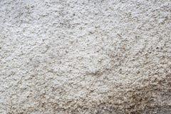 Struttura di pietra grigia approssimativa sporca bianca del muro di cemento immagini stock libere da diritti