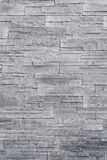 Struttura di pietra grigia della parete dell'impiallacciatura fotografia stock