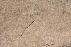 Struttura di pietra naturale di superficie Grungy di roccioso Immagine Stock