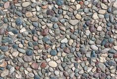 Struttura di pietra rotonda della roccia della parete e fondo senza cuciture Fotografia Stock