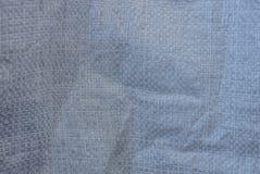 Struttura di plastica di bianco grigio fatta della borsa del cellofan immagini stock libere da diritti