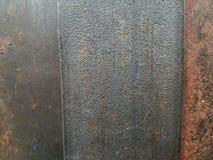 Struttura di superficie del metallo con tre pannelli verticali in primo piano immagine stock libera da diritti