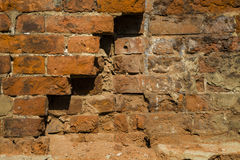 Struttura di un muro di mattoni con una crepa Immagini Stock Libere da Diritti