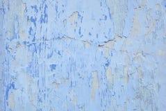 Struttura di una parete bianca con le crepe blu Immagine Stock Libera da Diritti