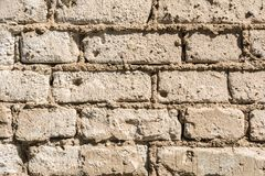 Struttura di vecchia parete dei blocchetti del mattone, del mattone sparso e della muratura, fondo astratto di architettura Fotografie Stock Libere da Diritti