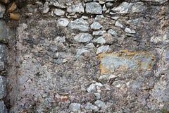 Struttura di vecchia parete di pietra di una fortezza medievale Sfondo naturale del primo piano Immagini Stock