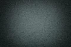 Struttura di vecchio fondo di carta verde scuro, primo piano Struttura di cartone bluastro profondo denso immagine stock