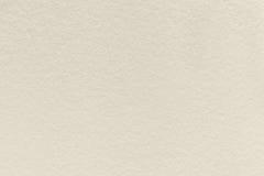 Struttura di vecchio fondo di carta beige leggero, primo piano Struttura del cartone denso della sabbia fotografia stock libera da diritti